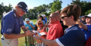 Ernie Els signs autographs after the third round of the Quicken Loans National at the Congressional Country Club in Bethesda, Maryland. (Photo by Bill Workinger / Voice of America)